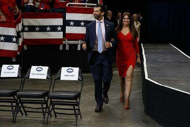 Donald Trump Jr. and Kimberly Guilfoyle arrive for President Donald Trump's re-election kickoff rally at the Amway Center, Tuesday, June 18, 2019, in Orlando. (AP Photo/Evan Vucci)