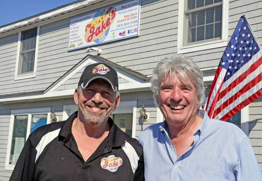 Jeff 'Jake' Russell, left, and Stuart Walls stand outside Jake's Diggity Dogs, which Russell recently opened at 40 Broad Street in downtown Milford, in a building that Walls owns. Photo: Jill Dion, Hearst Connecticut Media