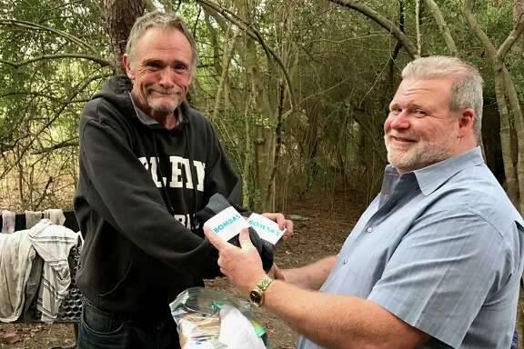 Ray Walker (right) is one of the staff members at H.O.P.E helping homeless individuals find a better way of life.