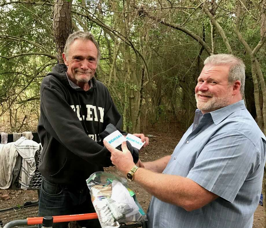 Ray Walker (right) is one of the staff members at H.O.P.E helping homeless individuals find a better way of life. Photo: H.O.P.E Haven