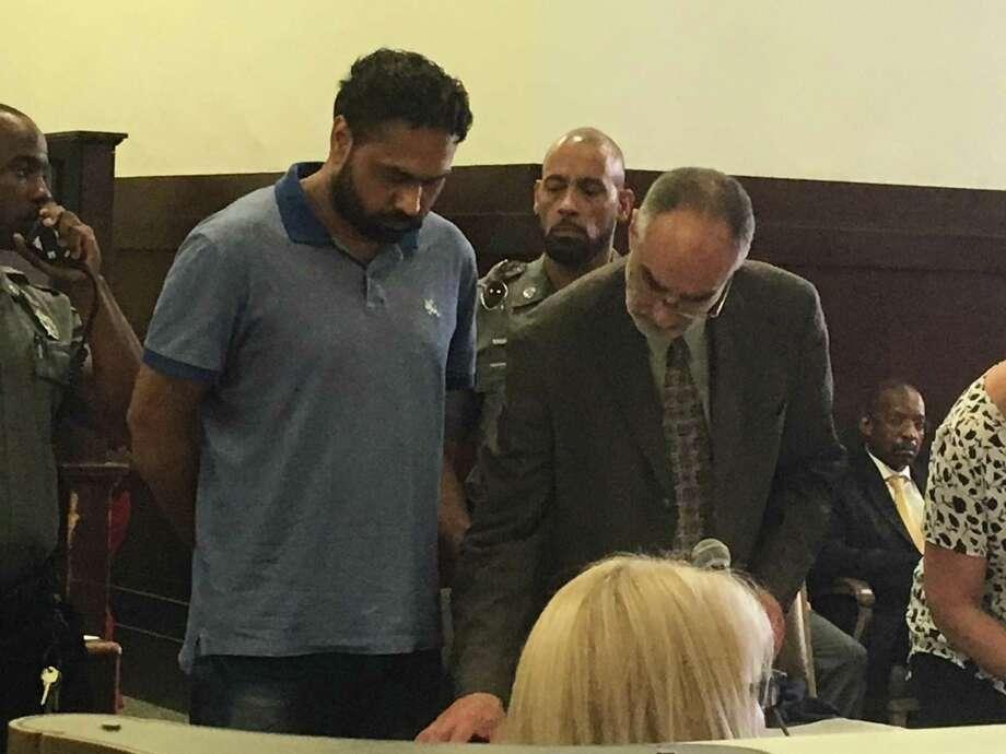 Gurpreet Singh, a suspect in an April 28 quadruple homicide of four family members in West Chester Township, Ohio, was arraigned at Superior Court in New Haven Wednesday. He waived extradition. At right is court-appointed Public Defender David Forsythe.Singh was picked up Tuesday in the parking lot of the Branford Walmart, according to Branford police. Photo: Mark Zaretsky / Hearst Connecticut Media