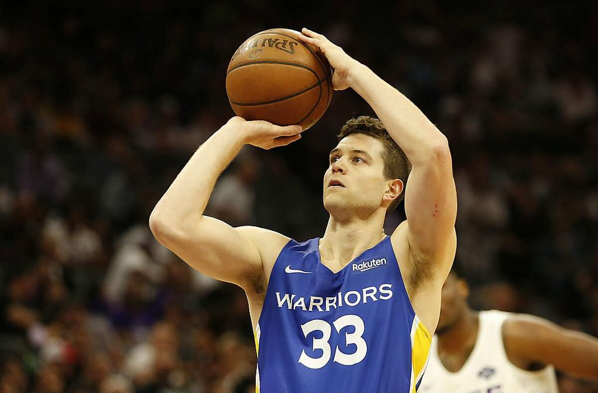 In this photo taken Monday July 1, 2019, Golden State Warriors guard Jimmer Fredette shoots a free throw during the first half of an NBA basketball summer league game against the Sacramento Kings in Sacramento. He left the team after two summer league games to join a team in Greece.