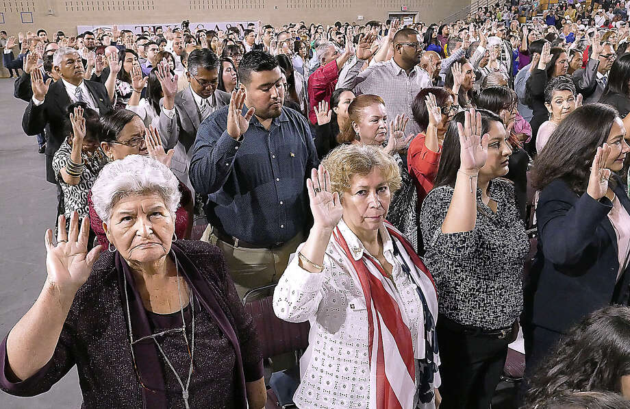 Corina Pena, left, was among hundreds who took the Oath of Allegiance from the Honorable Judge Diana Saldana, U.S. District Judge for the Southern District of Texas at the U.S. District Court for the Southern District of Texas Naturalization Ceremony Tuesday, July 2, 2019 at TAMIU. Photo: Cuate Santos/Laredo Morning Times