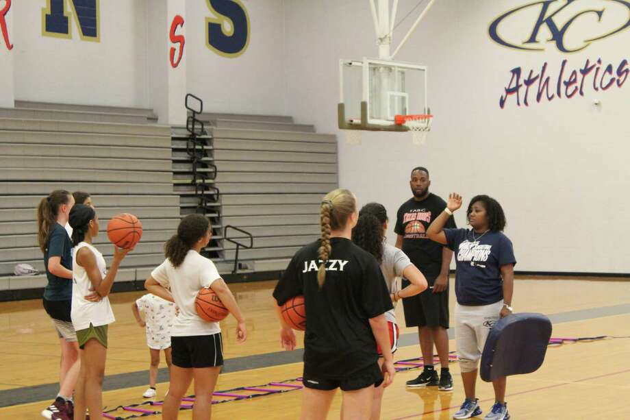 Klein Collins head girls basketball coach Tatiana Lee and assistant coach/junior varsity head coach Justin Jones talk to athletes during a skills session at the Klein Collins High School gym, June 25, 2019. Photo: Alvaro Montano