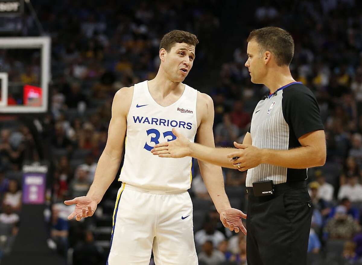 Golden State Warriors guard Jimmer Fredette questions referee Mark Lindsay after he was called for an offensive foul during the second half of the team's NBA basketball summer league game against the Los Angeles Lakers in Sacramento, Calif., Tuesday, July 2, 2019. (AP Photo/Rich Pedroncelli)