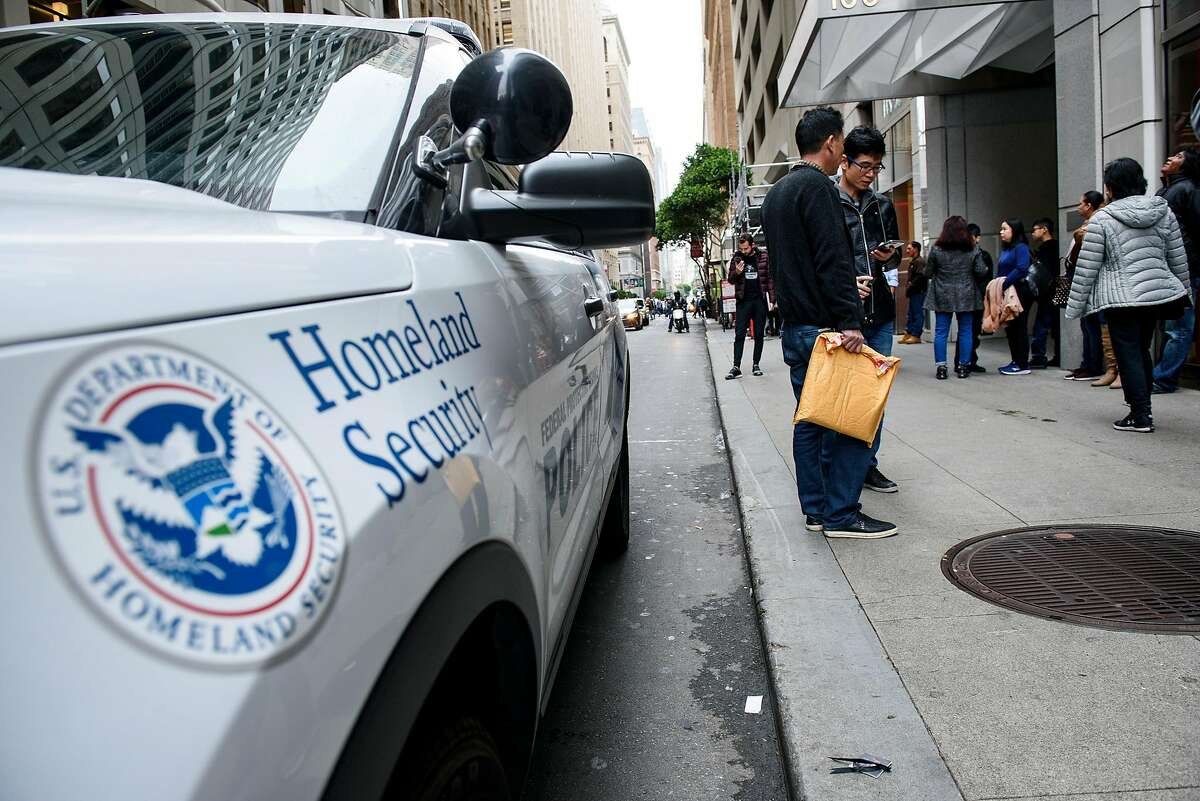 A Department of Homeland Security police vehicle is seen as people wait with their paperwork outside of San Francisco Immigration Court in San Francisco, Calif., on Thursday, January 31, 2019.