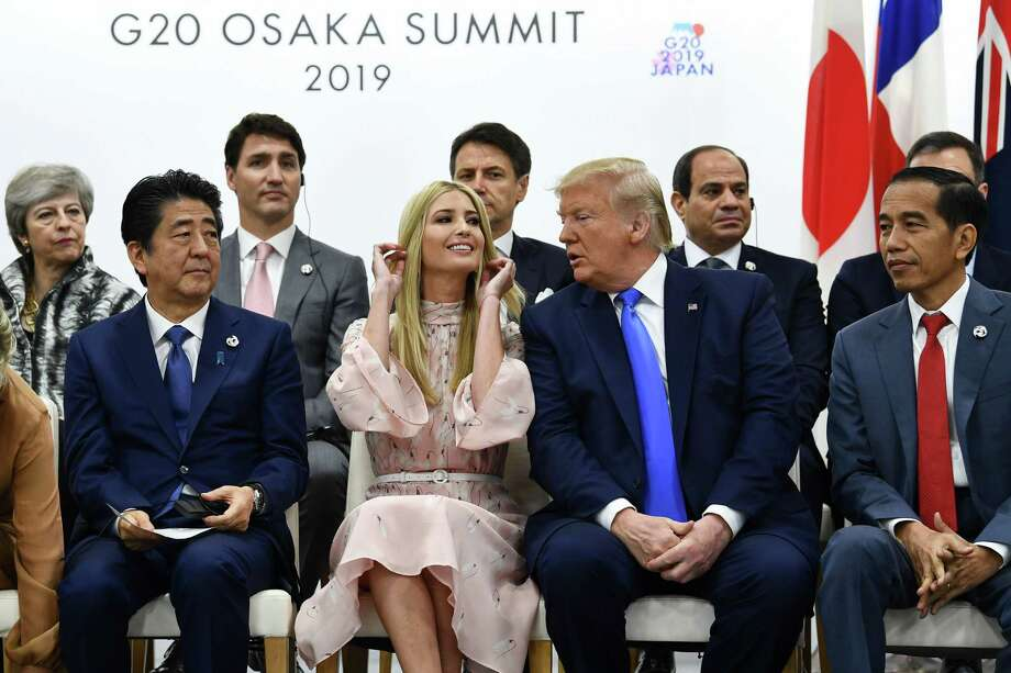 (FILES) In this file photo taken on June 29, 2019 (front L-R) Japan's Prime Minister Shinzo Abe, advisor to the US President Ivanka Trump, US President Donald Trump and Indonesia's President Joko Widodo attend an event on women's empowerment during the G20 Summit in Osaka. - Ivanka Trump got a ribbing back home on July 1, 2019 after critics took issue with the prominent role played by President Donald Trump's daughter during summits in Japan and South Korea. Ivanka Trump's official capacity is advisor to the president and she is a constant presence in the White House. (Photo by Brendan Smialowski / AFP)BRENDAN SMIALOWSKI/AFP/Getty Images Photo: BRENDAN SMIALOWSKI, Contributor / AFP/Getty Images / AFP or licensors