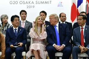 (FILES) In this file photo taken on June 29, 2019 (front L-R) Japan's Prime Minister Shinzo Abe, advisor to the US President Ivanka Trump, US President Donald Trump and Indonesia's President Joko Widodo attend an event on women's empowerment during the G20 Summit in Osaka. - Ivanka Trump got a ribbing back home on July 1, 2019 after critics took issue with the prominent role played by President Donald Trump's daughter during summits in Japan and South Korea. Ivanka Trump's official capacity is advisor to the president and she is a constant presence in the White House. (Photo by Brendan Smialowski / AFP)BRENDAN SMIALOWSKI/AFP/Getty Images