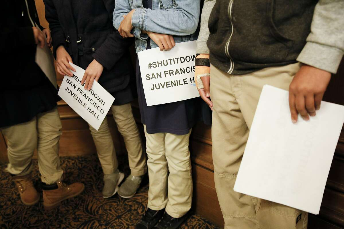 San Francisco Islamic School students silently protest for the shutdown of juvenile hall during a committee meeting at City Hall Thursday, May 16, 2019, in San Francisco, Calif. The S.F. Government Audit and Oversight Committee discussed ordinance that would close the city's juvenile hall by the end of 2021.