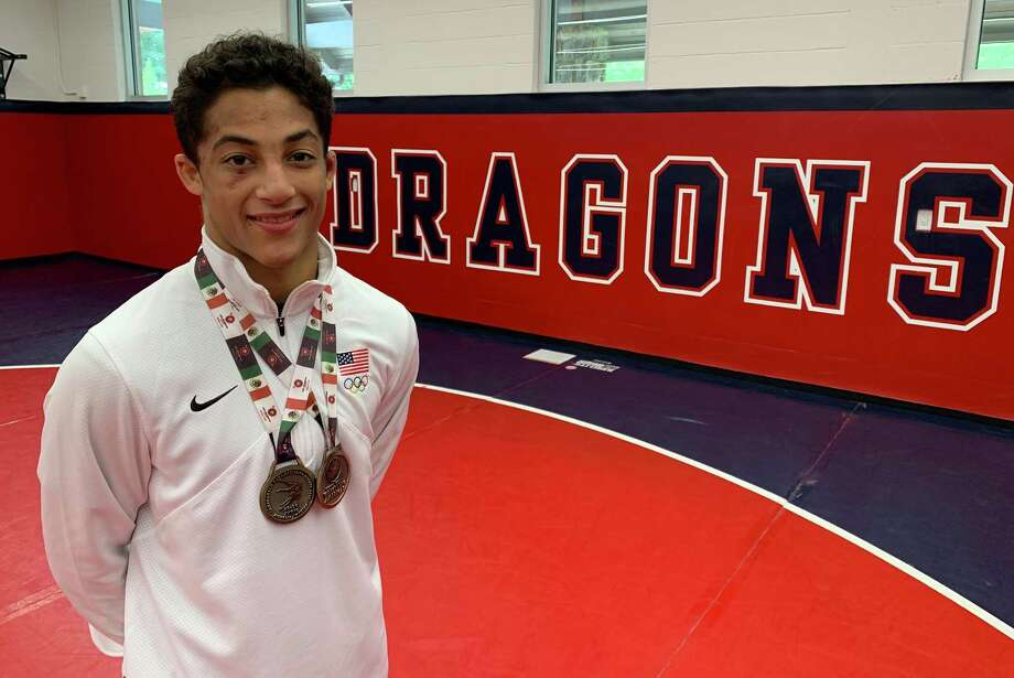 Greens Farms Academy rising junior Nico Provo, a resident of Stratford, shows off the two medals he won while competing in the 2019 Pan American Cadet Games in Mexico last week. Provo, competing at 51 kilograms (112.4 pounds) went undefeated and won gold in freestyle while taking a bronze medal in Greco-Roman. Photo: John Nash / Greens Farms Academy / Contributed Photo / Stamford Advocate Contributed