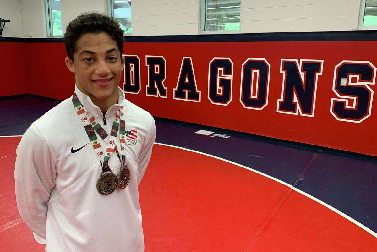 Greens Farms Academy rising junior Nico Provo, a resident of Stratford, shows off the two medals he won while competing in the 2019 Pan American Cadet Games in Mexico last week. Provo, competing at 51 kilograms (112.4 pounds) went undefeated and won gold in freestyle while taking a bronze medal in Greco-Roman.