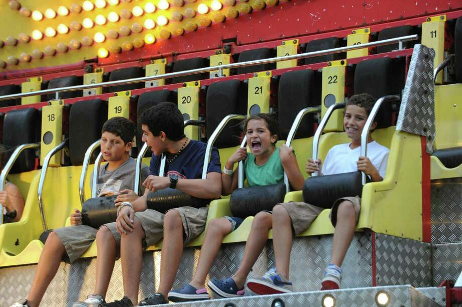 The annual Carnival of Fun at St. Catherine of Siena Church in Greenwich's Riverside section returns July 9-13. Photo: Hearst Connecticut Media File Photo / Greenwich Time