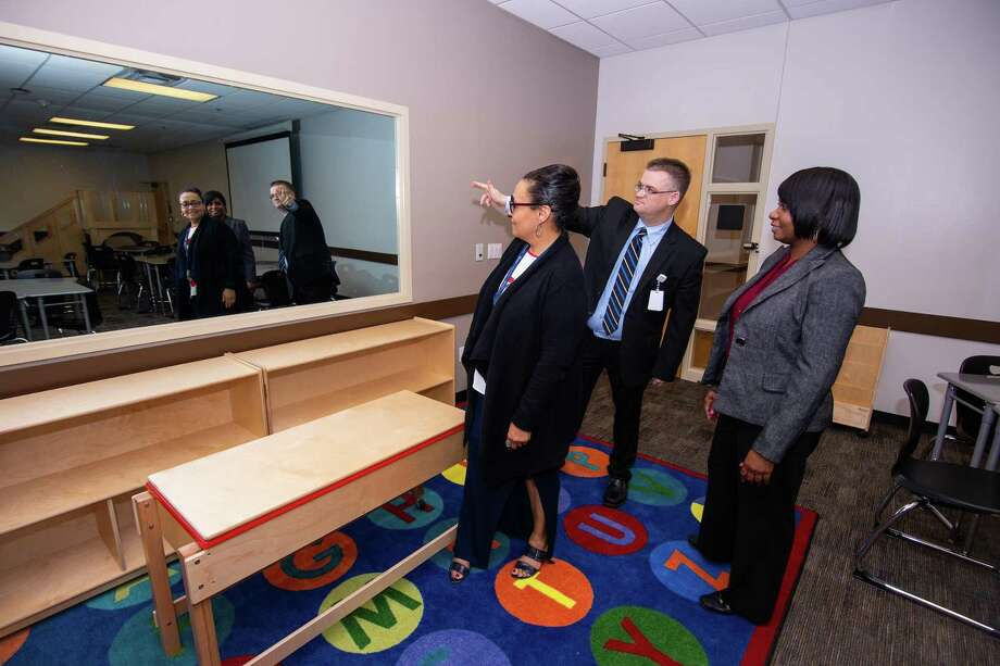 Spring ISD Executive Directors Marie Mendoza, from left, Robert Lundin and Katherine Fisher discuss features of the simulation classrooms that are a key element of the recently opened TeachUp Spring Learning Center, the new home of the district's workforce development program Photo: Spring ISD / SPRING ISD SPRING ISD