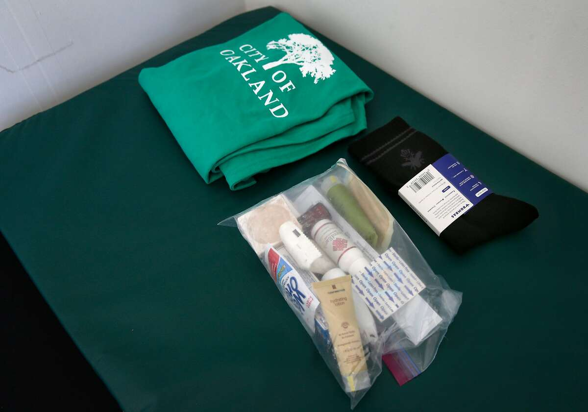 Housewarming gifts including toiletries and a pair of socks await residents of the newest community of portable sheds for the homeless below the MacMarthur Maze in Oakland, Calif. on Wednesday, July 3, 2019. The first of the 80 or so residents are scheduled to move into the tiny homes near Wood and 34th streets on Sunday.