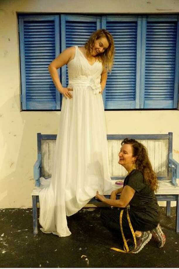 Jamie Grawitch as Sophie, and Emily Truckenbrod as Donna, discuss Sophia's upcoming wedding during a dress fitting. Photo: Valerie Goldston | For The Telegraph