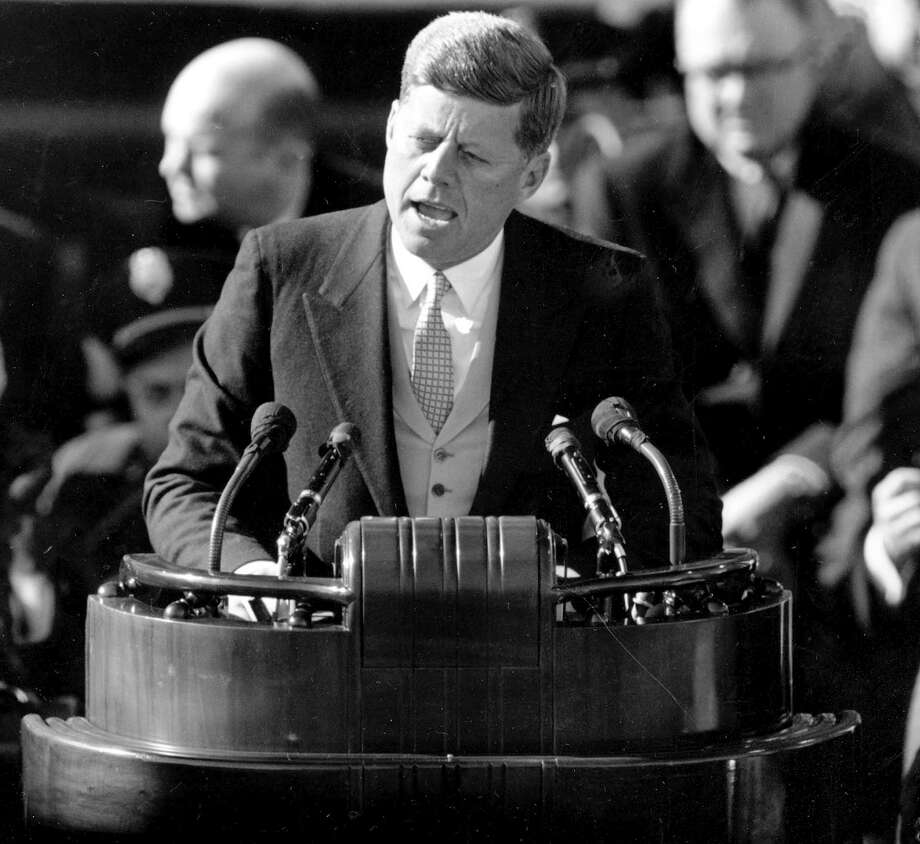 "What is being American all about? In his inaugural address in 1961, President John F. Kennedy called on Americans to heed the command of Isaiah to 'undo the heavy burdens and to let the oppressed go free.'"" Photo: Anonymous /AP / AP1961"