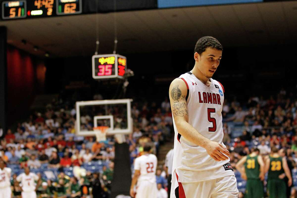 DAYTON, OH - MARCH 14: Mike James #5 of the Lamar Cardinals walks towards the bench in the second half after he fouled out against the Vermont Catamounts in the first round of the 2011 NCAA men's basketball tournament at UD Arena on March 14, 2012 in Dayton, Ohio. (Photo by Gregory Shamus/Getty Images)