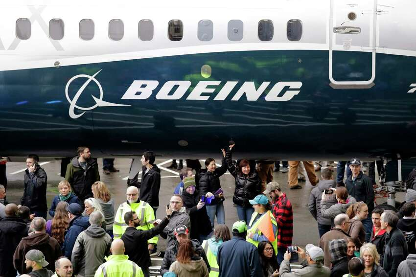 FILE- In this Feb. 5, 2018, file photo a Boeing 737 MAX 7, the newest version of Boeing's fastest-selling airplane, is displayed during a debut for employees and media of the new jet in Renton, Wash. Boeing says it's providing $100 million over several years to help families and communities affected by two crashes of its 737 Max plane that killed 346 people. The company said Wednesday, July 3, 2019, that some of the money will go toward living expenses and to cover hardship suffered by the families of dead passengers. (AP Photo/Elaine Thompson, File)