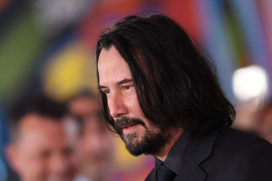 """FILE - Keanu Reeves arrives for the world premiere of """"Toy Story 4"""" at El Capitan theatre in Hollywood, California on June 11, 2019. The actor was reportedly hanging out in Alameda ahead of shooting next month for """"Matrix 4."""" Photo: Valerie Macon, AFP/Getty Images"""