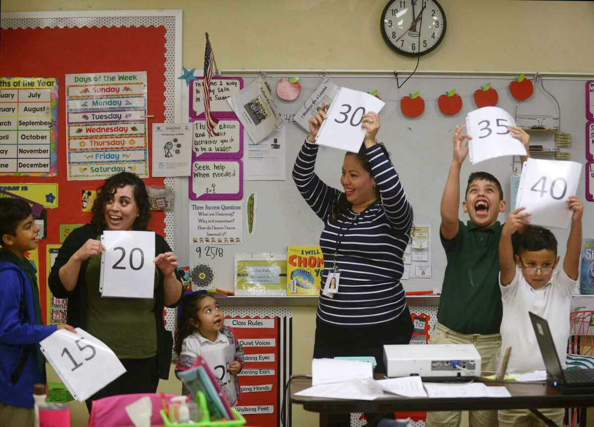 Special education teacher Veronica De Los Santos, middle, leads her class in an exercise in which students and teachers line up according to the number that they draw during class at Green Academy on Sept. 25, 2018. With De Los Santos are, from left, Jhoan Ahumada, teaching assistant Jennifer Huizar, Abcde Rodriguez, Angel Flores and Alex Martinez.