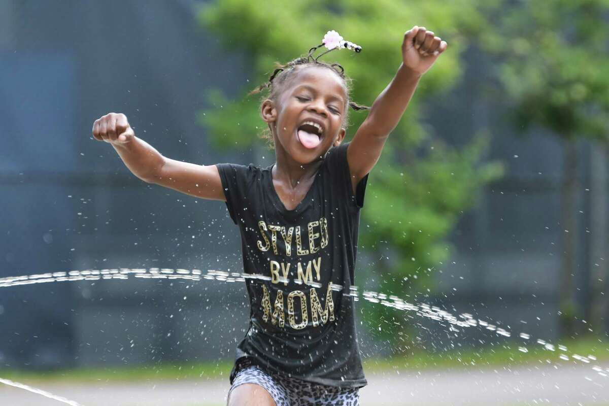 Kahshahvea Leroy, 6, cools off from the heat at the splash pad at Swinburne Park on Wednesday, July 3, 2019, in Albany, N.Y. (Paul Buckowski/Times Union)