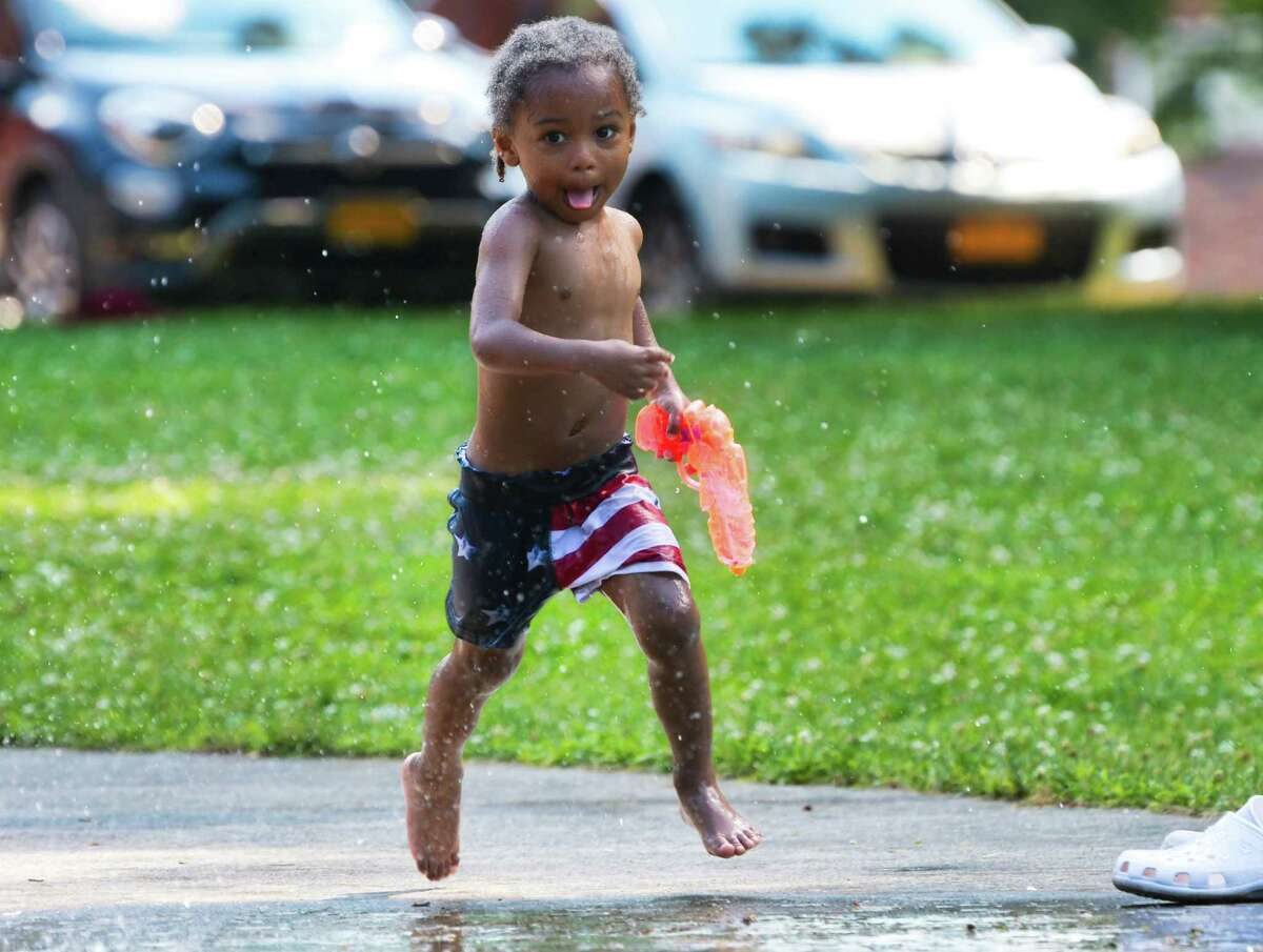 Nachone Rozier, 3, cools off from the heat at the splash pad at Swinburne Park on Wednesday, July 3, 2019, in Albany, N.Y. (Paul Buckowski/Times Union)
