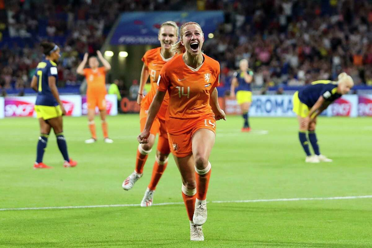 Netherlands' Jackie Groenen celebrates after scoring during the Women's World Cup semifinal soccer match between the Netherlands and Sweden, at the Stade de Lyon outside Lyon, France, Wednesday, July 3, 2019. (AP Photo/Francisco Seco)