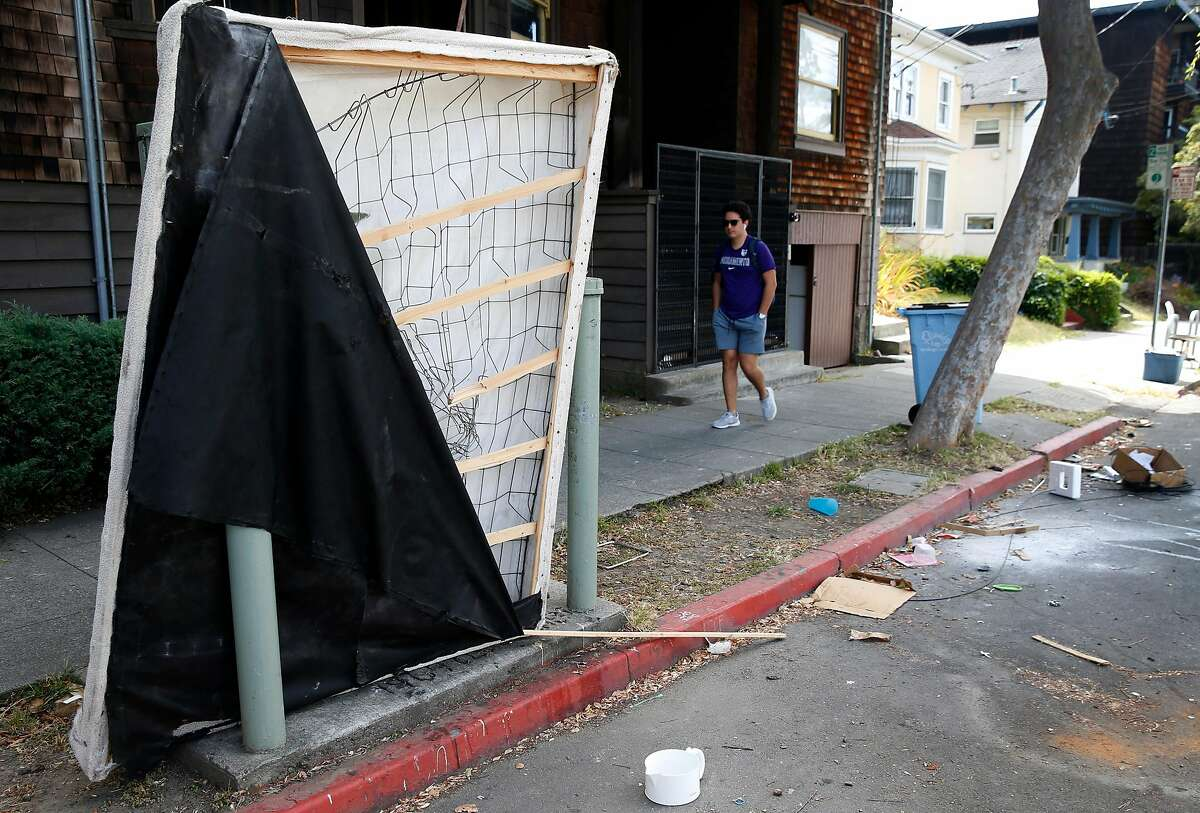 Mattresses and other debris are abandoned on Ellsworth Street after Cal students have moved out of apartments for the summer break in Berkeley, Calif. on Thursday, June 27, 2019. Phil Bokovoy is among a group of residents who have filed lawsuits against UC Berkeley over the negative impact that the rising student enrollment has had on the surrounding neighborhoods.