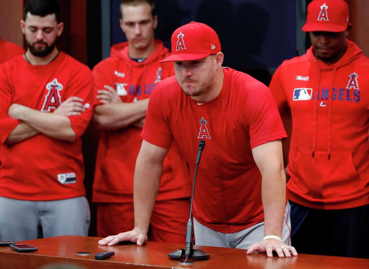 Los Angeles Angels' Mike Trout fights back tears as he answers questions about Tyler Skaggs, who died Monday, during a news conference after the Angels' baseball game against the Texas Rangers in Arlington, Texas, Tuesday, July 2, 2019. (AP Photo/Tony Gutierrez)