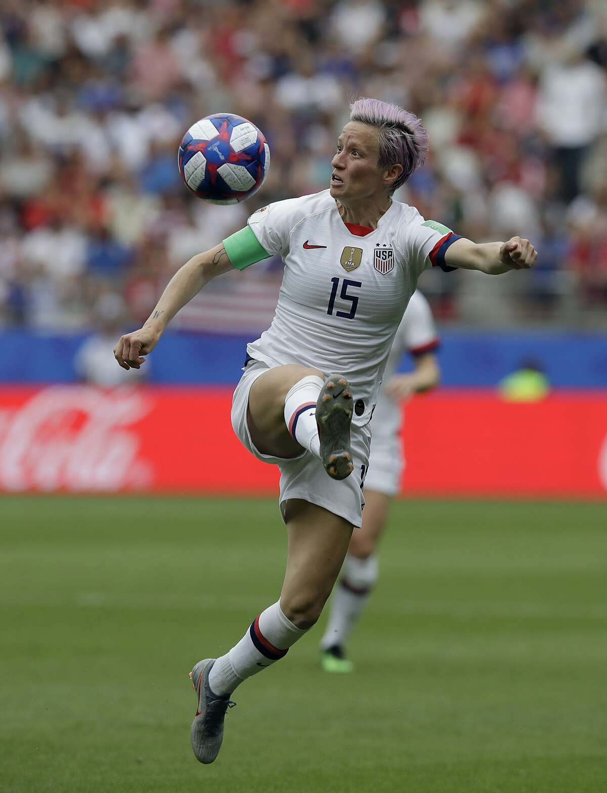 United States'Megan Rapinoe controls the ball during the Women's World Cup round of 16 soccer match between Spain and US at the Stade Auguste-Delaune in Reims, France, Monday, June 24, 2019. (AP Photo/Alessandra Tarantino)