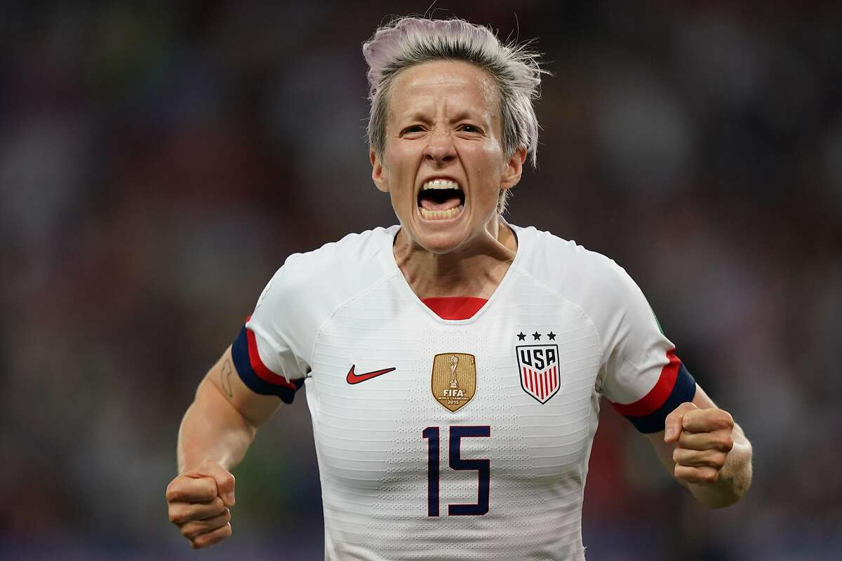 TOPSHOT - United States' forward Megan Rapinoe celebrates after scoring a goal during the France 2019 Women's World Cup quarter-final football match between France and USA, on June 28, 2019, at the Parc des Princes stadium in Paris. (Photo by Lionel BONAVENTURE / AFP)LIONEL BONAVENTURE/AFP/Getty Images