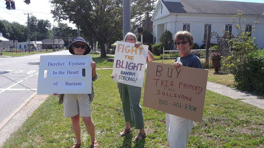 From left, Carol Powers, Anne Haas and Lauren Sage protest blight in the Bantam Borough. Photo: Emily M. Olson / Hearst Connecticut Media