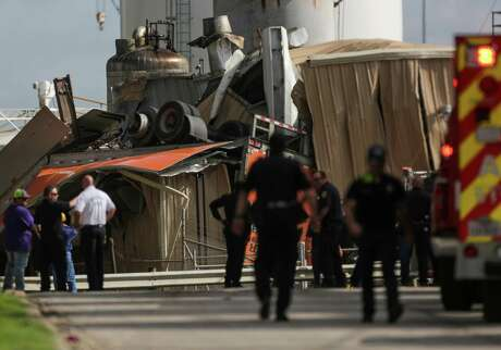 Houston police and fire officials cordon off a water tank where an 18-wheeler drove off northbound Loop 610 near the Houston Ship Channel on Wednesday.