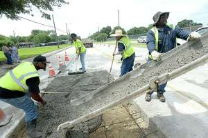 """City of Beaumont workers brave the elements as they lay fresh concrete on a stretch of S. Fourth Street Thursday. A heat advisory was issued for Southeast Texas Thursday, with """"feel like"""" temperatures over 100 degrees. The high heat is expected to continue through Friday. People are advised to stay hydrated, wear protective head covering and avoid strenuous activity for prolonged periods of time.  Photo taken Thursday, June 20, 2019  Kim Brent/The Enterprise"""