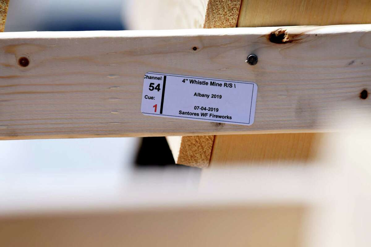 A label placed on a rack for firework shells in preparation for the 43rd annual Independence Day fireworks show at Empire State Plaza on Wednesday, July 3, 2019, in Albany, N.Y. Each slot is labeled to correspond with the matching shell that will be timed to go off in time with the music played at the celebration. (Catherine Rafferty/Times Union)