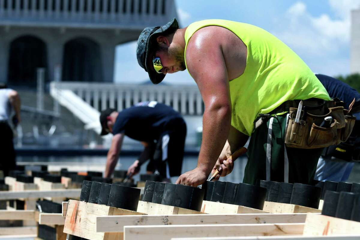 Jeff Carrozza Jr., member of the pyro crew of Santore's World Famous Fireworks, hammers together racks for firework shells in preparation for the 43rd annual Independence Day fireworks show at Empire State Plaza on Wednesday, July 3, 2019, in Albany, N.Y. There will be approximately 10,000 fireworks shells fired during the celebration. (Catherine Rafferty/Times Union)