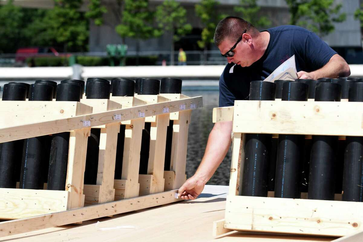 Jeff Ward, member of the pyro crew of Santore's World Famous Fireworks, labels racks for firework shells in preparation for the 43rd annual Independence Day fireworks show at Empire State Plaza on Wednesday, July 3, 2019, in Albany, N.Y. Bethlehem will continue its tradition of pre-Thanksgiving Day fireworks, but at Elm Avenue Park on Nov. 25, 2020. (Catherine Rafferty/Times Union)