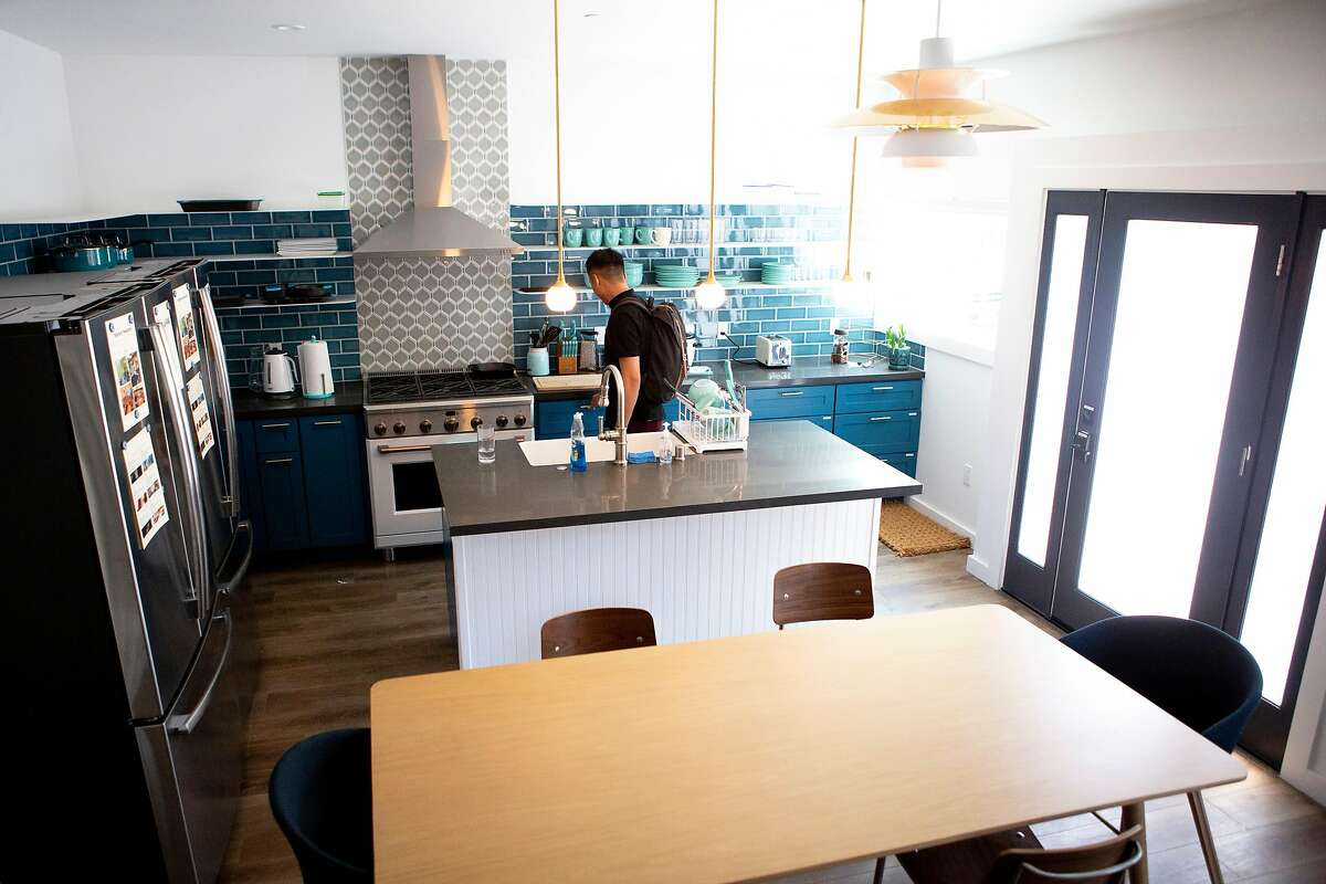 Starcity manager Ellis Tran tours the Starcity co-living kitchen at 1856 McAllister on Wednesday, July 3, 2019, in San Francisco, Calif. Starcity is a a co-living development company.