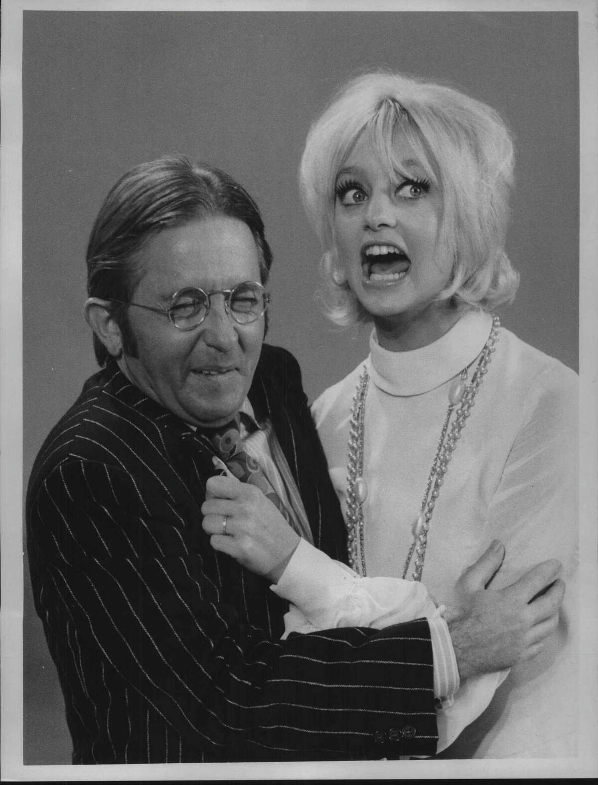 """Arte Johnson, as Rozmenko, teaches Russian tune to Goldie Hawn on """"Rowan and Martin's Laugh-In"""" in color over NBC-TV Monday, March 30. Undated (Times Union Archive)"""