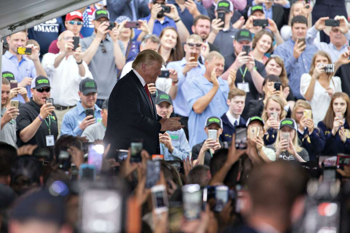 President Donald Trump arrives at an event at the Southwest Iowa Renewable Energy ethanol facility in Council Bluffs, Iowa last month. Months after the Environmental Protection Agency, was expected to begin issuing exemptions from the most recent ethanol requirements, refineries are still waiting for word. The delay follows Trump's Iowa's visit.