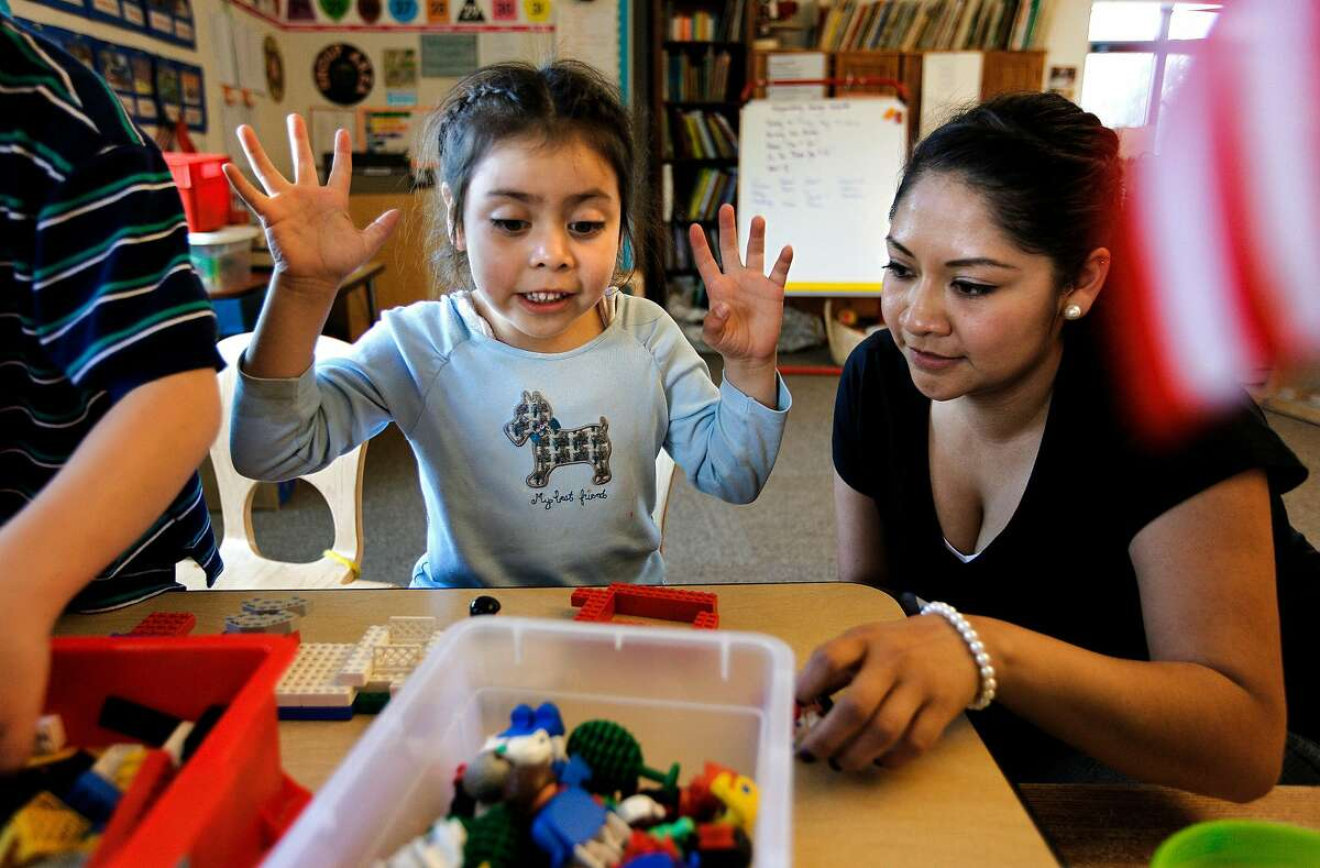 Amparo Martinez picks up her daughter Sarah Perea, 5-years-old, at the Holy Family Day Home in San Francisco on May 14, 2010.