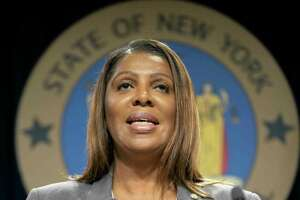 New York Attorney General Letitia James speaks during a news conference, Tuesday, June 11, 2019, in New York. A group of state attorneys general led by New York and California filed a federal lawsuit Tuesday to block T-Mobile's $26.5 billion bid for Sprint, citing consumer harm. (AP Photo/Mary Altaffer)