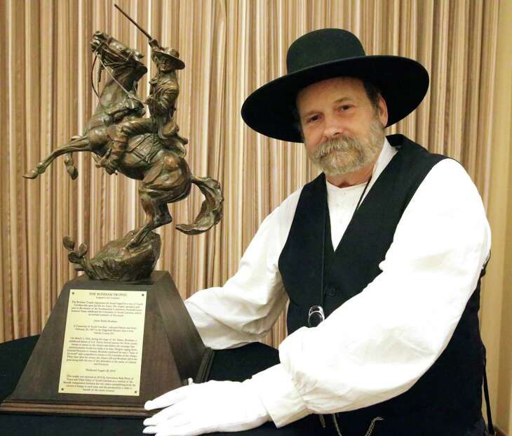 Bruce Winders, Alamo Historian and Curator, displays the Bonham Trophy on June 5, 2019 which will be exchanged between the governors of Texas and South Carolina as winners are determined in the Texas A&M versus University of South Carolina football rivalry.