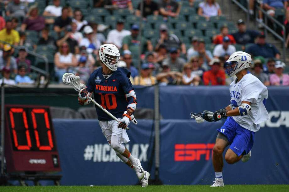 Virginia's Xander Dicksonmoves the ball upfield during the Division I Men's Lacrosse semifinals on May 25. Photo: Larry French / NCAA Photos Via Getty Images / 2019 NCAA Photos