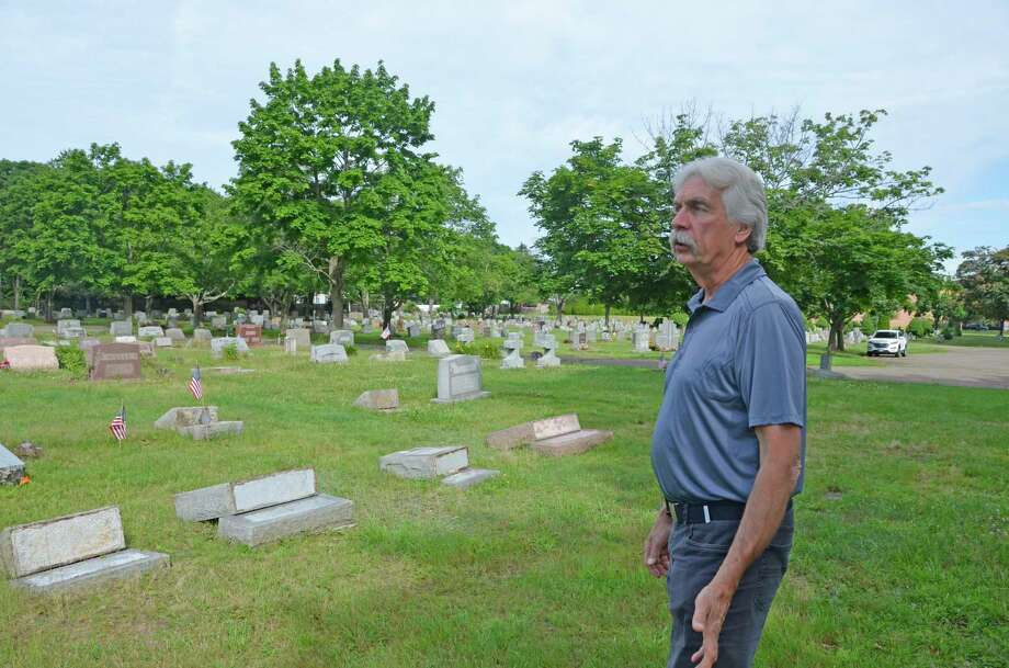 Ray Scholl says the damage done at two Milford cemeteries recently is the most extensive he has seen in his 34 years as superintendent of the Milford Cemetery Association. Nearly 50 headstones were knocked over or broken. Photo: Jill Dion / Hearst Connecticut Media