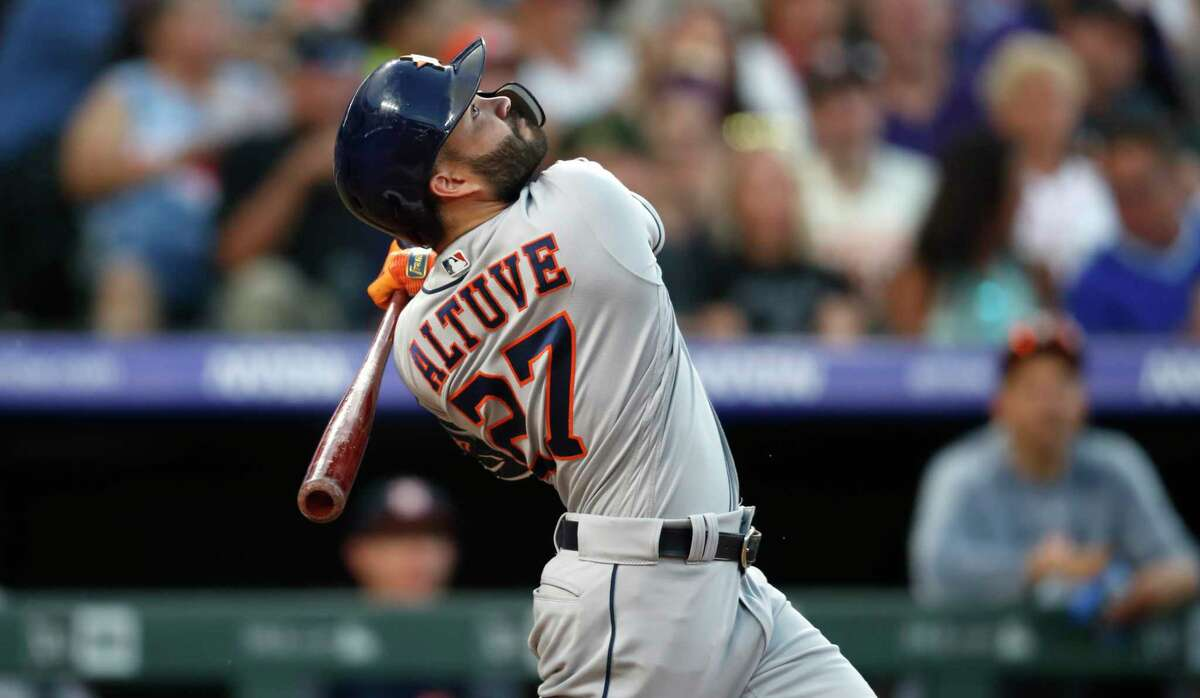 Houston Astros' Jose Altuve pops out against Colorado Rockies relief pitcher Chad Bettis during the seventh inning of a baseball game Wednesday, July 3, 2019, in Denver. (AP Photo/David Zalubowski)