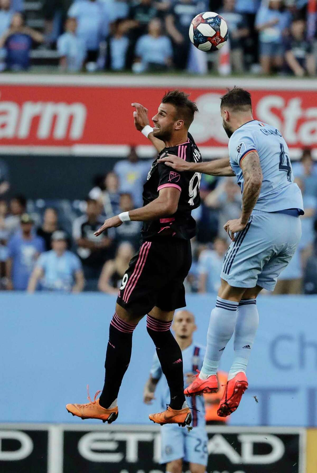 Seattle Sounders's Justin Dhillon, left, jump up to head the ball as New York City's Maxime Chanot defends during the first half of an MLS soccer match Wednesday, July 3, 2019, in New York. (AP Photo/Frank Franklin II)