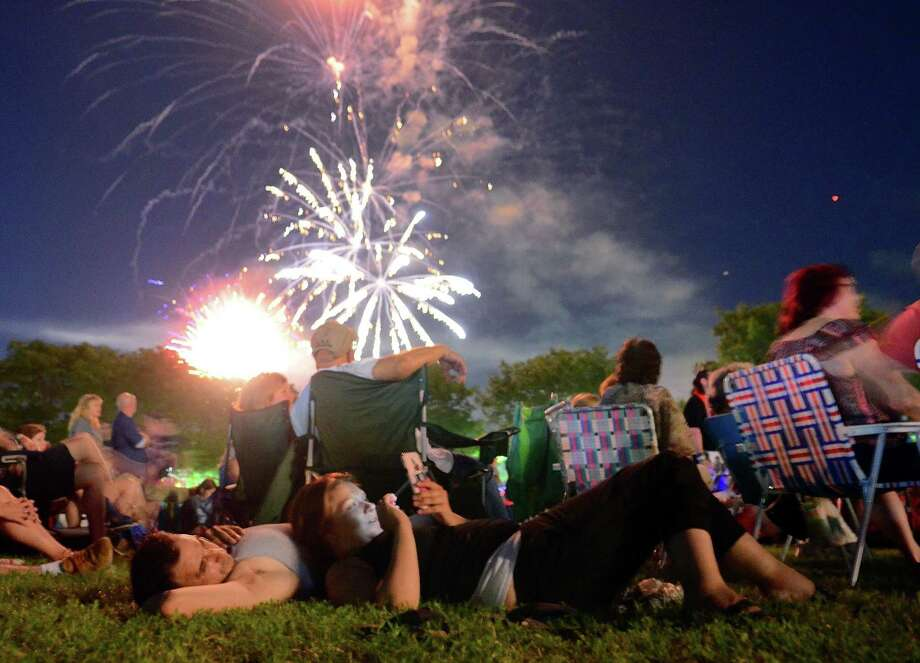 Donna Catalano and Ari Karagiannis, of Shelton, watch the Debry/Shelton 4th of July fireworks from Veteran's Park in Shelton, Conn., on Wednesday July 3, 2019. Photo: Christian Abraham / Hearst Connecticut Media / Connecticut Post