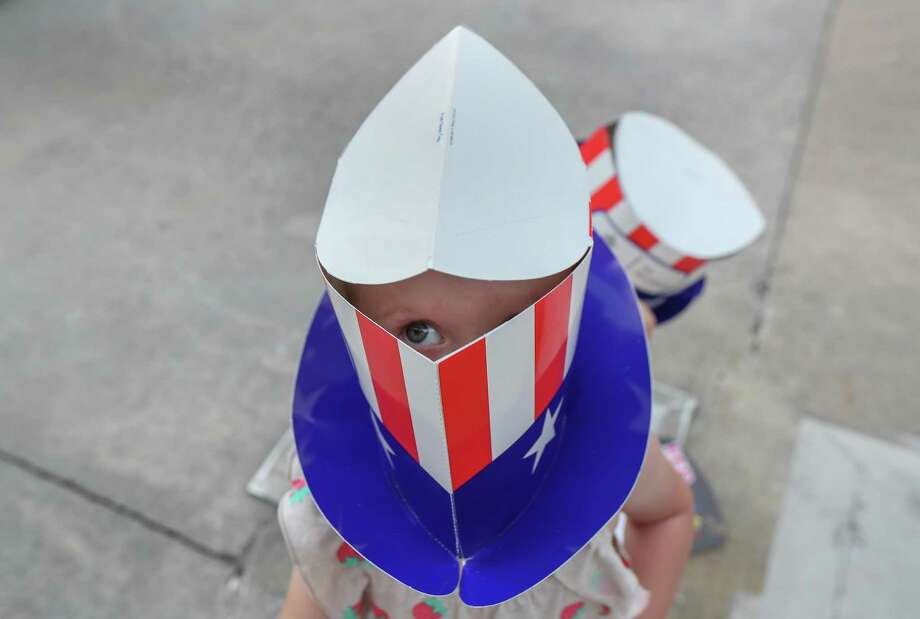 Molly Bull, 1, found a way to see from under a hat before the Houston Symphony Star-Spangled Salute honoring the 50th anniversary of the moon landing, NASA's Bill Davidson, and the armed forces at the Cynthia Wood Mitchell Pavilion Wednesday, July 3, 2019, in The Woodlands. Photo: Steve Gonzales, Houston Chronicle / Staff Photographer / © 2019 Houston Chronicle