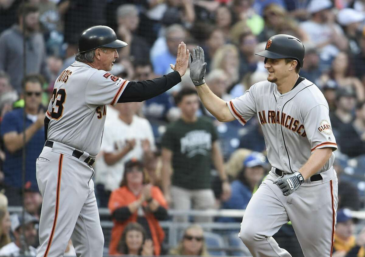 SAN DIEGO, CA - JULY 3: Alex Dickerson #8 of the San Francisco Giants, right, is congratulated by Ron Wotus #23 after hitting a solo home run during the third inning of a baseball game at Petco Park July 3, 2019 in San Diego, California. (Photo by Denis Poroy/Getty Images)